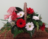 Basked of Germeni, Thistle and Chrysanthemums.  Finished with Ribbon