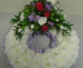 Based wreath with Roses, Carnations and Freesia