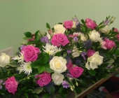 Beautiful Casket Spray with Pink Aqua and Avalanche Roses
