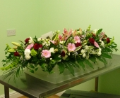5 Foot Casket Spray with Roses, Gerbera, Lilies, Freesia, September Flower, Spray Carnations and Mixed Foliage